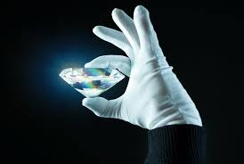 Diamond held by glove